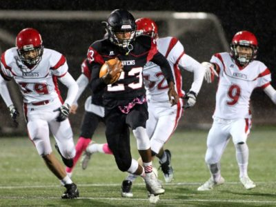 Terry Fox running back Jaden Severy breaks away from a trio of St. Thomas More tacklers in the first half of their BC High School Football Association AAA game, Friday at Percy Perry Stadium in Coquitlam. STM beat the top-ranked Ravens 15-8 (credit: Mario Bartel, The Tri-City News)