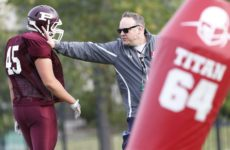 JOHN WOODS / WINNIPEG FREE PRESS St Paul's Crusader coach Stacy Dainard works with D lineman Colin Cornelson during practice at the school Tuesday, September 5, 2017.
