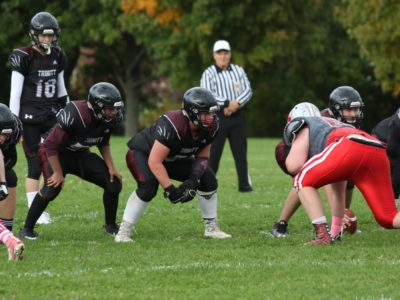 Lineman Finn uses football to open doors