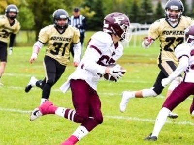 SB Theo Karahalios excels with a football and a basketball