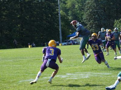 #3 Jordan Travis zeroes in on an interception with #53 Owen Macleod in coverage (Photo by Jason Romisher)