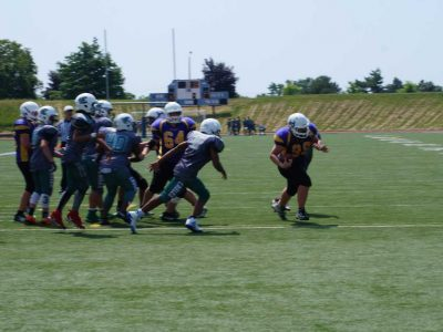 Jake Sheppard Rumbles to the endzone for his third touchdown of the game for the Huronia Stallions Bantam Squad (Photo by Jason Romisher)