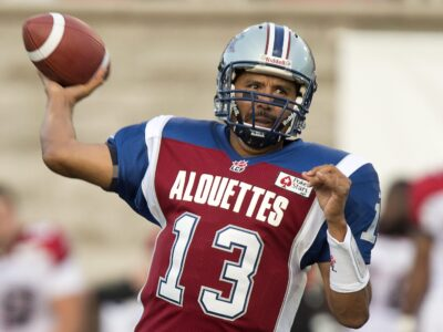 FILE - In this July 12, 2013, file photo, Montreal Alouettes quarterback Anthony Calvillo fires a pass down field against the Calgary Stampeders during first quarter CFL football action  in Montreal. Calvillo, 41, the the CFL's career passing leader, will not play again this season after being out for more than two months with a concussion, the team annoucned Friday, Oct. 18, 2013. (AP Photo/The Canadian Press, Paul Chiasson, File)
