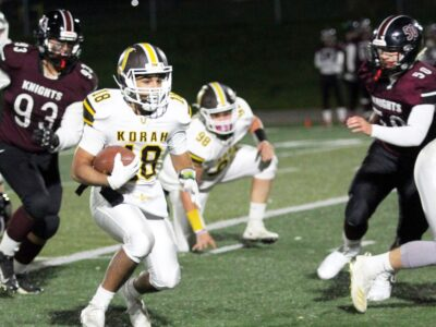 PETER RUICCI Korah running back Michael Nicoletta weaves his way in and out of traffic during the Colts 42-3 victory over the St. Mary's Knights in the recent High School Senior Football League final.