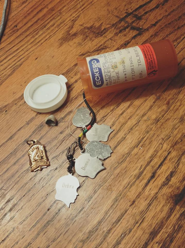 My mother's actual pill bottle full of things.