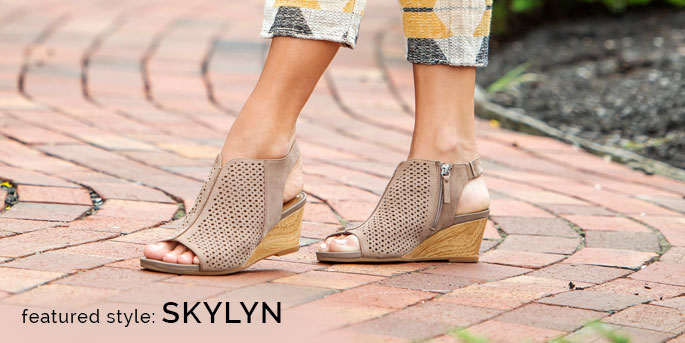 Featured Style: Skylyn perforated pattern wedge, shown in grey.  Shop Skylyn