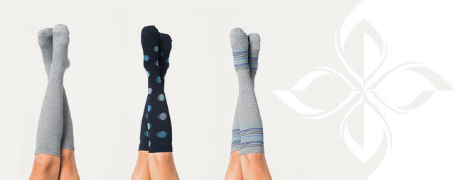 Featured Style: Compression socks. Three models with feet in the air wearing compression socks
