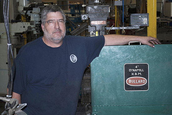 John Kunzel with old mill sign
