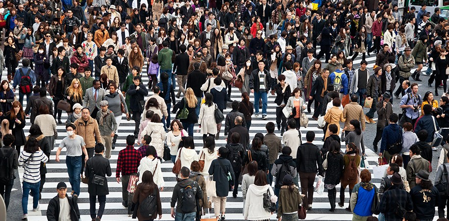TOKYO, JAPAN - NOVEMBER 20: Unidentified pedestrians at Shibuya crossing on November 20, 2010 in Tokyo, Japan. The intersection is one of the busiest and most famous scramble crosswalks in the world.