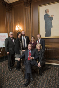 The Honorable William Webster seated with (L-to-R) Thomas Stipanowich, Sky Yancey Stipanowich, Patrick Simmons, the Honorable Beth Robb, Alan Sender, and Lynda Webster (kneeling).