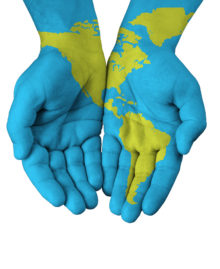 World map painted on hands isolated on white