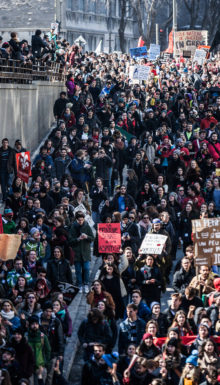 MONTREAL CANADA APRIL 02 2015. Riot in the Montreal Streets to counter the Economic Austerity Measures. Top View of the Protesters Walking in the Packed Streets