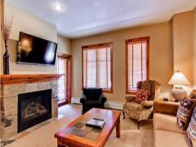 Living room with gas fireplace & large flat screen TV