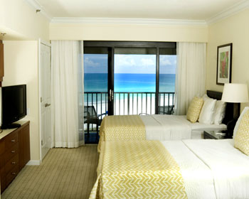 Guest Room Beach View - come complete with two double beds, a dressing area, refrigerator with ice maker, microwave, and private balcony. (415 square feet)