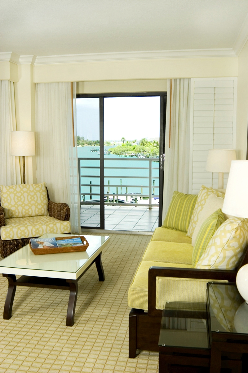 Junior Suite Lagoon View- have one king-size bed in a spacious living/sleeping area, a queen-size sleeper sofa, plus a kitchenette with washer/dryer, dressing room, and private balcony. (650 square feet)