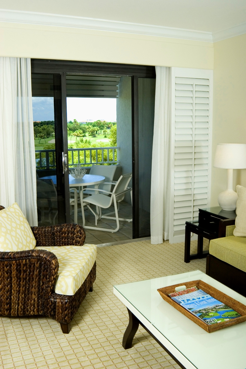 Junior Suite Golf Course View- have one king-size bed in a spacious living/sleeping area, a queen-size sleeper sofa, plus a kitchenette with washer/dryer, dressing room, and private balcony. (650 square feet)