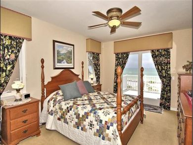 Upstairs master bedroom with queen bed