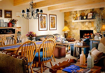 Sample living and dining room with fireplace