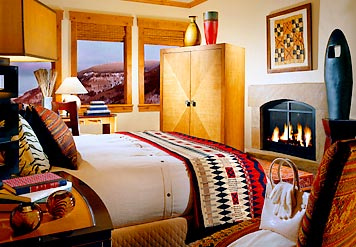 Sample bedroom with fireplace & mountain view