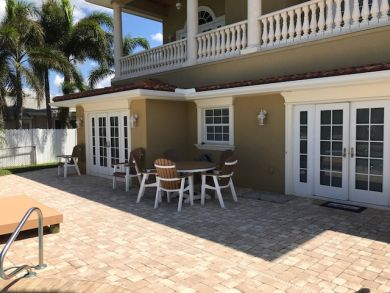 One of the Best 5 Bedroom Homes on Anna Maria with Boat Dock