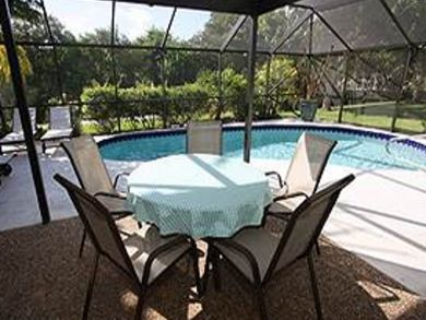Outdoor dining area on pool deck