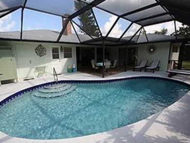 Private pool with sun loungers & dining area