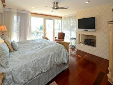 Master bedroom with fireplace & flat screen TV