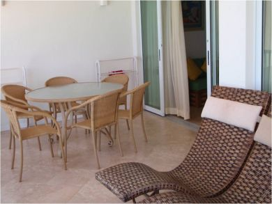 Balcony with table set & sun loungers