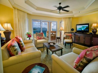 Sea view living area with flat screen TV