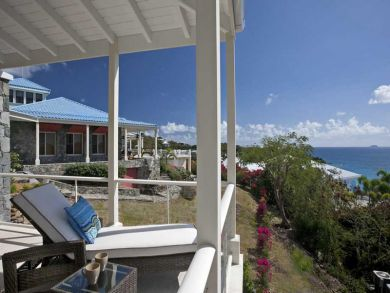 Beach front balcony with sun loungers