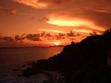 Sun falls with a blaze of color into the Caribbean Sea in winter