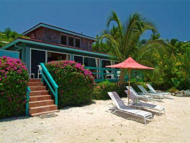 Sandy beach with sun loungers