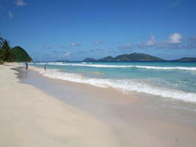 The mile-long beach at long bay is just steps from the villa