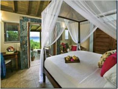 The master suite offers a romantic 4-poster bed