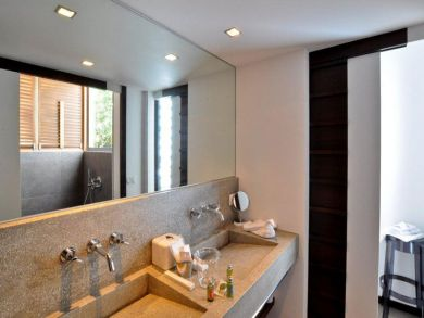 Bathroom with walk-in shower & two sinks