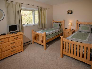 Twin beds in third bedroom