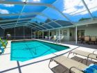 Stunning 4 bedroom screened pool canalfront home