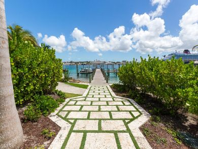 Contemporary Beachfront Estate with Private Boat!
