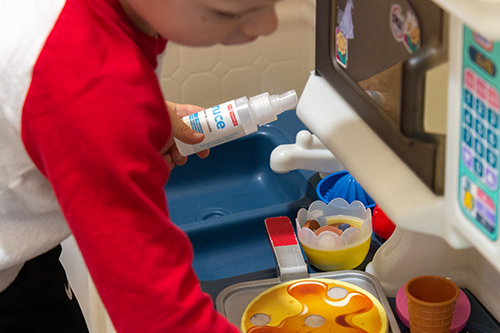 Kids using Truce All-Purpose Cleaner to clean their kitchen toys