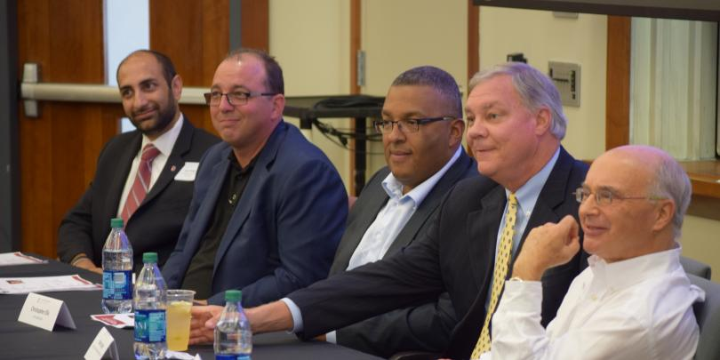 Real Estate professionals gather to discuss the real estate field.