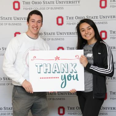 Two Fisher students are holding a Thank You sign
