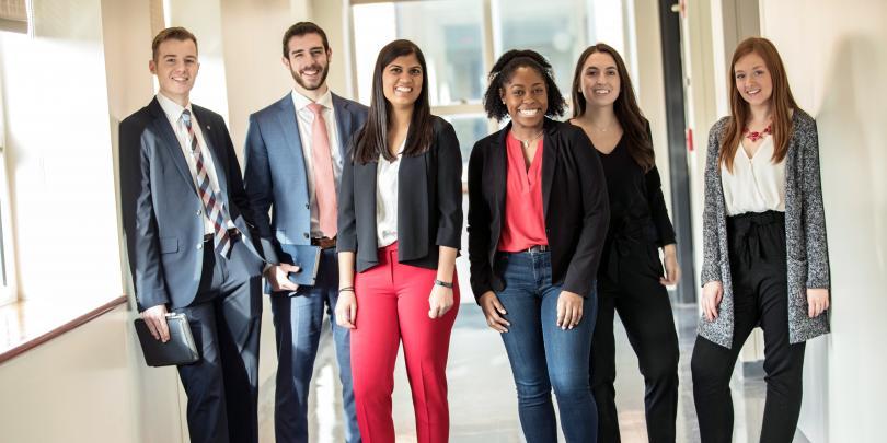 Six students standing in Schoenbaum Hall hallway