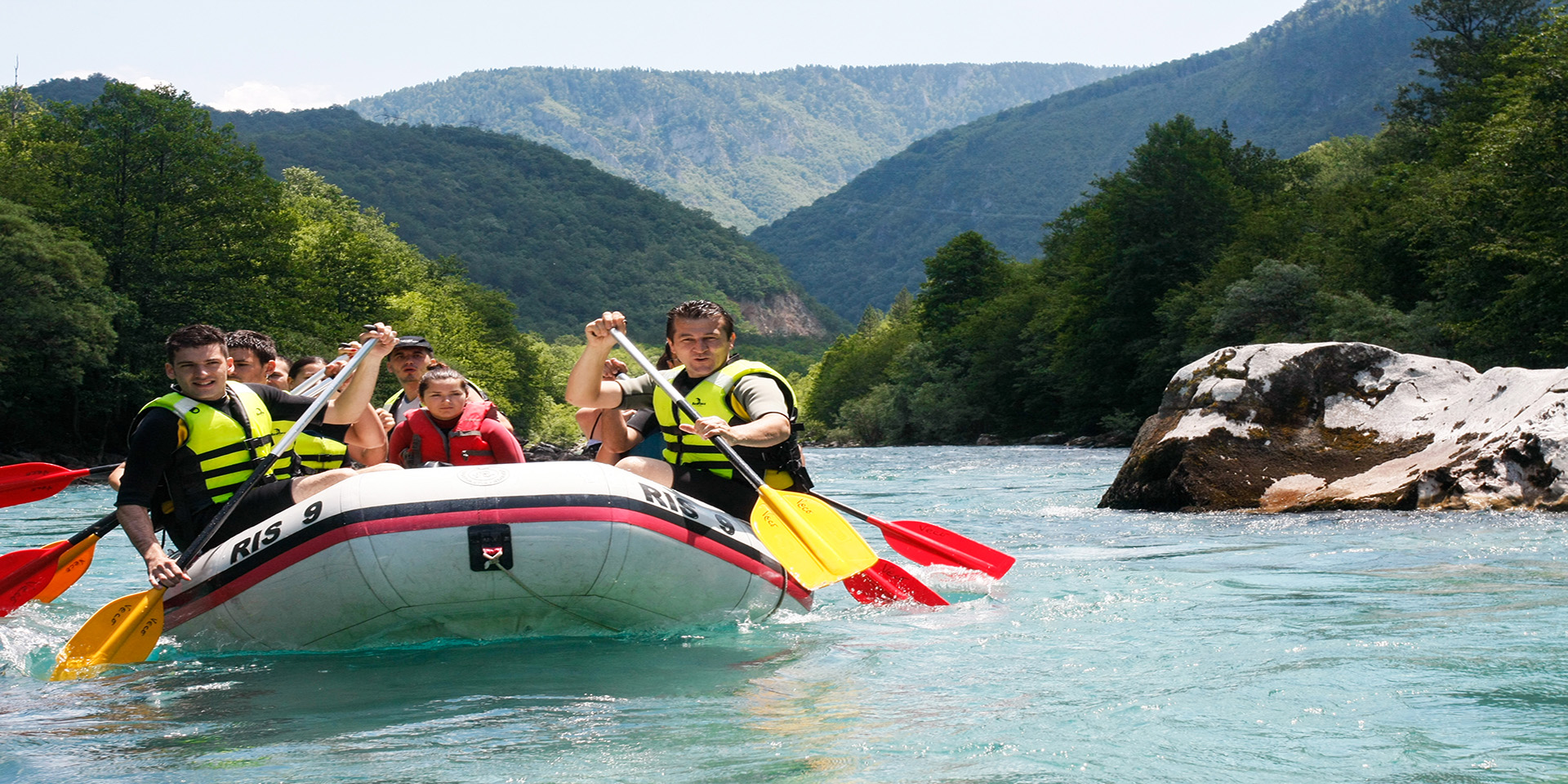 group of students whitewater rafting