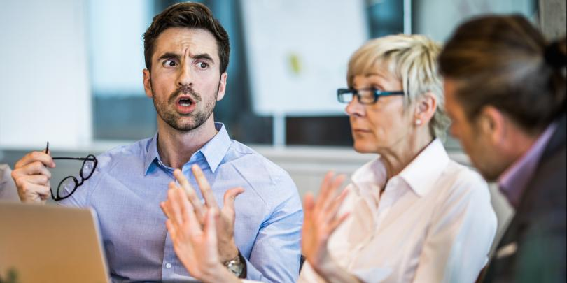 Man looking angry in office meeting