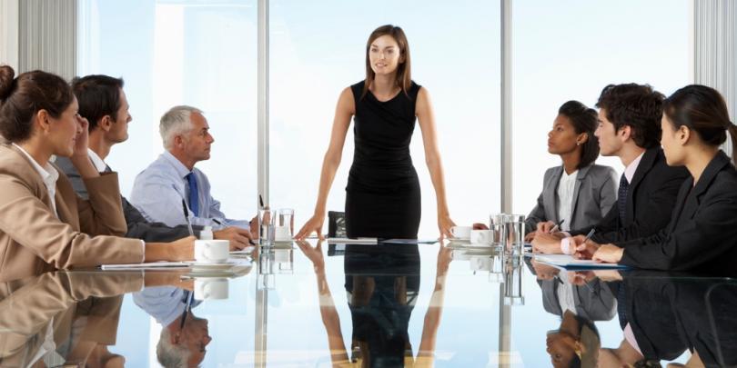 Female CEO leading board meeting
