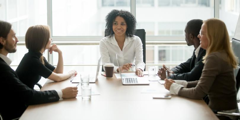 Woman at head of board meeting