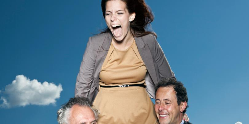 A woman being propped up by two men