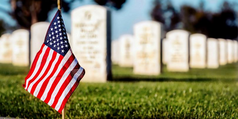 American flag in a military graveyard