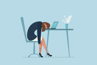 Illustration of woman face-down on desk looking sad