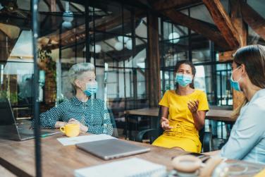 People wearing masks in an office